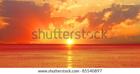 Beautiful sunset over the ocean - stock photo