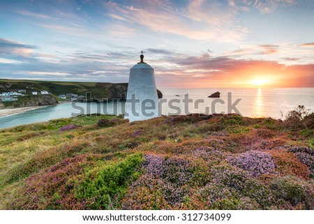 Beautiful sunset over the Pepperpot lighthouse at Portreath in a carpet of late summer heather - stock photo