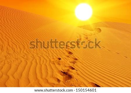 Beautiful sunset over the sand dunes in the Sahara desert, Tunisia - stock photo