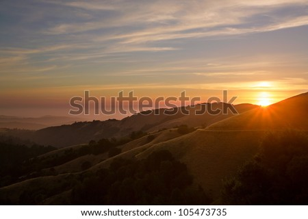 Beautiful sunset over the Santa Cruz Mountains of California with Pacific Ocean in background - stock photo