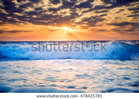 Beautiful sunset over the sea in long exposure as background