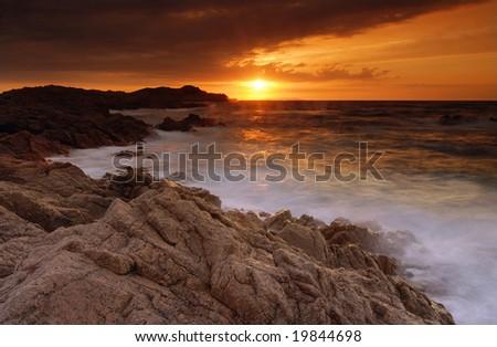 Beautiful sunset over the sea on Sardinia, Italy - stock photo