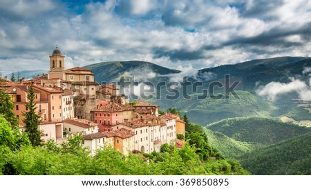 Beautiful sunset over the small town, Umbria, Italy - stock photo