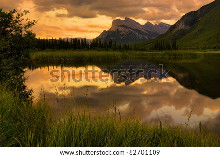 Beautiful sunset over the Vermillion Lakes in the Canadian Rockies. Mount Rundle in the distance. - stock photo