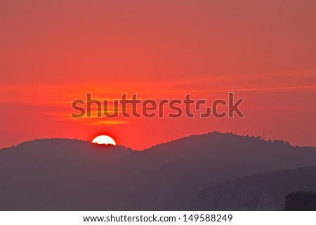 Beautiful Sunset. Red Sun, Mountain. High quality stock photo. - stock photo