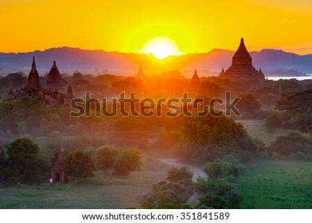 Beautiful sunset scene of Ancient Pagoda in Bagan , Myanmar - stock photo
