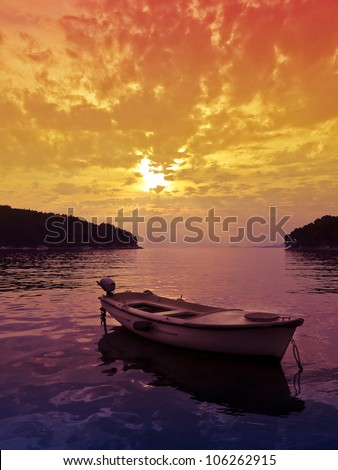 Beautiful Sunset scene with a small boat