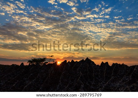 Beautiful sunset silhouette of the unique geography at the Tsingy de Bemaraha Strict Nature Reserve in Madagascar - stock photo