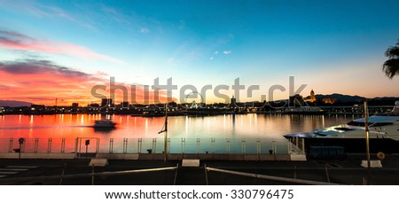 Beautiful sunset sky in the marine port. Panoramic view of the port of Malaga at sunset. - stock photo