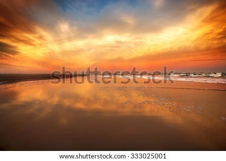 Beautiful sunset sky on the ocean beach - stock photo