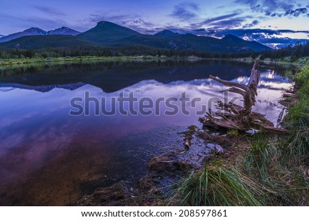 Beautiful sunset sky over Lily Lake - Rocky Mountain National Park Colorado - stock photo