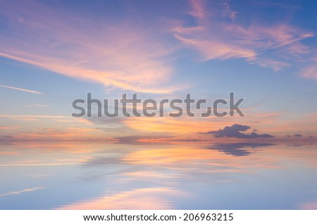 beautiful sunset sky with reflection in water - stock photo