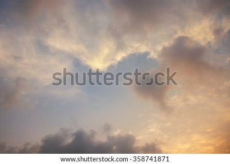Beautiful sunset sky with yellow sunny clouds