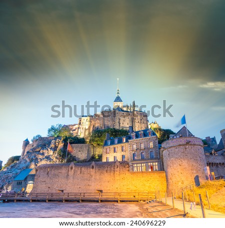 Beautiful sunset skyline of Mont Saint Michel in Normandy, France. - stock photo