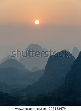 Beautiful sunset. The view from the top of the Vine Mountains near Guilin - China - stock photo