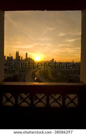 beautiful sunset view in kuala lumpur city from a window - stock photo