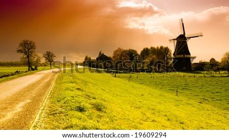 beautiful sunset windmill landscape in the netherlands - stock photo