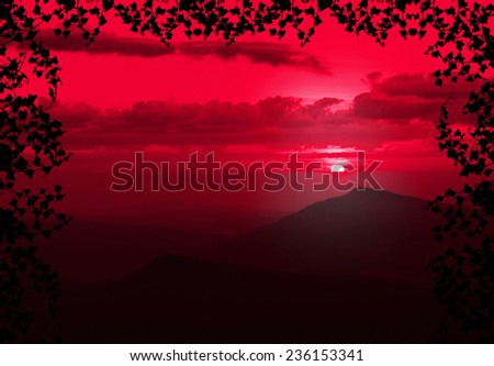 Beautiful sunset with cloud and mountain,tree foreground siluette frame,red color tone - stock photo
