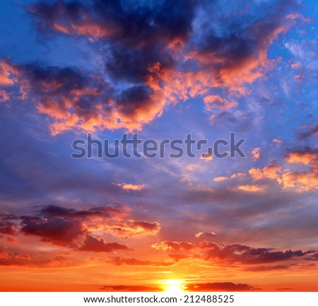 Beautiful sunset with clouds - stock photo
