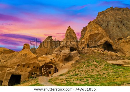 beautiful sunset with clouds cave houses of Cappadocia and Goreme National Park. Urgup, Goreme, Guzelyurt and Uchisar. Turkey.