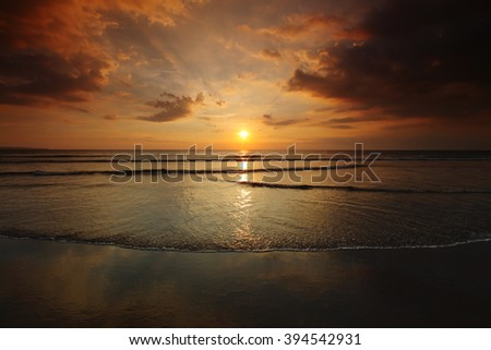 Beautiful sunset with clouds over tropical sea - stock photo