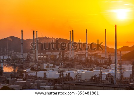Beautiful sunset with oil refinery plant in heavy petrochemical industry estate use for power ,energy and petroleum industrial topic