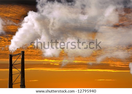 beautiful Sunset  with smokestack generating pollution adding to global warming