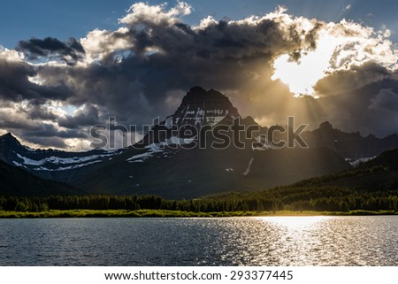 Beautiful sunset with Swiftcurrent Lake, Glacier National Park - stock photo