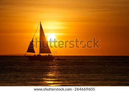 Beautiful sunset with yacht at Boracay, Philippines - stock photo