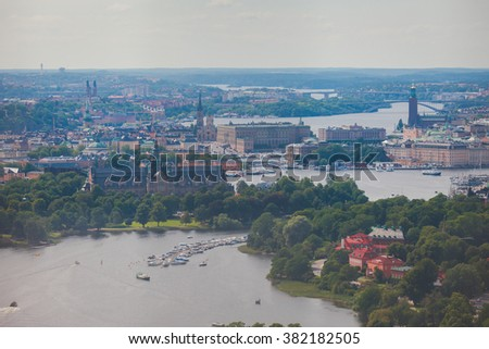 Beautiful super wide-angle panoramic aerial view of Stockholm, Sweden with harbor and skyline with scenery beyond the city, seen from the observation tower, sunny summer day with blue sky  - stock photo