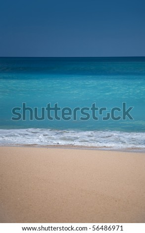 Beautiful surfing sand beach on sunny summer day