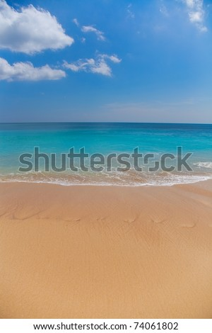 Beautiful surfing tropical sand beach on sunny summer day - stock photo