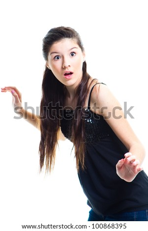 beautiful  surprised teenager girl with long dark hair wearing black on isolated white background - stock photo