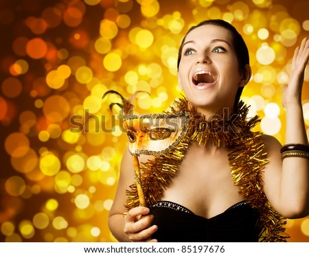 beautiful surprised woman with carnival mask - stock photo