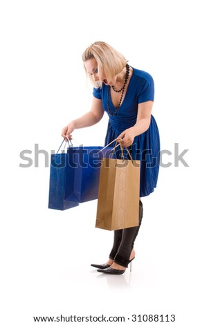 Beautiful surprised young woman with purchase - stock photo