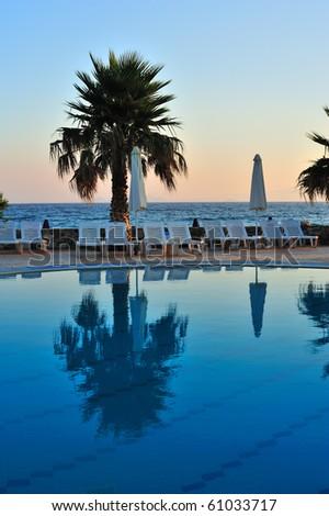 Beautiful swimming pool at sunrise - stock photo