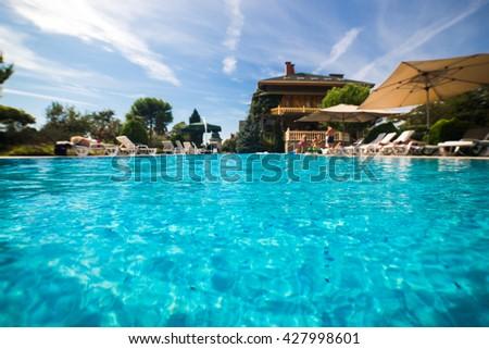 Beautiful swimming pool in tropical resort , close up - stock photo
