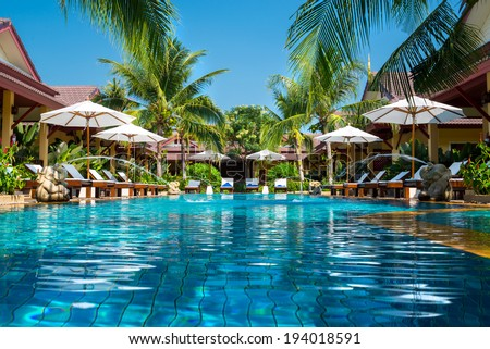 beautiful swimming pool in tropical resort , Phuket, Thailand.  - stock photo
