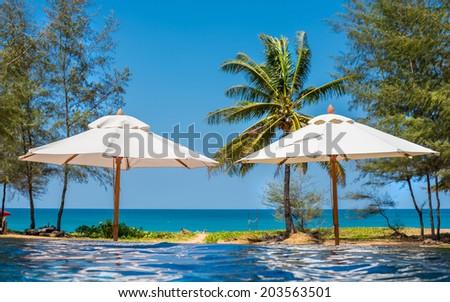 beautiful swimming pool in tropical resort , Phuket, Thailand - stock photo