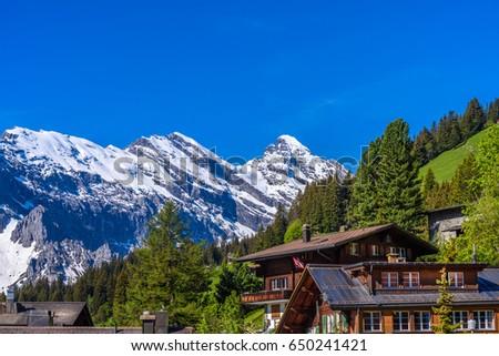 Swiss Mountain House beautiful swiss mountain valley landscape house stock photo