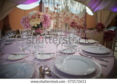 Beautiful table setting a festive table. Beauty, kitchenware, tableware design. - stock photo