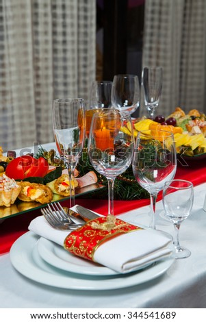 Beautiful table setting for Christmas party or New Year celebration Beautiful Christmas table setting.Christmas themed dinner table. New Year party table. - stock photo