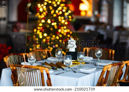 Beautiful table setting for Christmas party or New Year celebration in restaurant - stock photo
