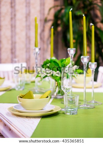 Beautiful table setting with white and green colors. Vertical composition. Shallow DOF - stock photo