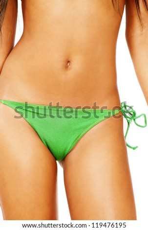 Beautiful tanned female body front torso closeup - stock photo