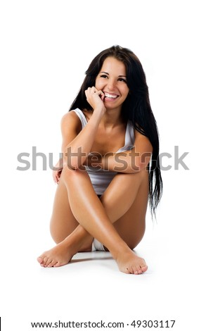 Beautiful tanned girl. Isolaed on a white background