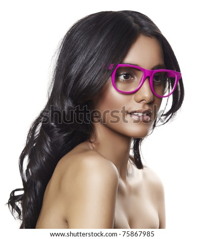 beautiful tanned woman with long curly hair wearing pink glasses. - stock photo