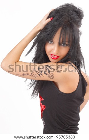 beautiful tattooed girl in black clothes with bright cosmetics - stock photo