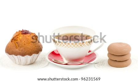 Beautiful tea set with cupcakes on white background