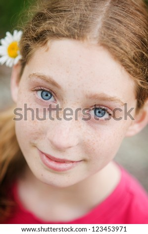 beautiful teen aged girl with blue eyes and freackles - stock photo
